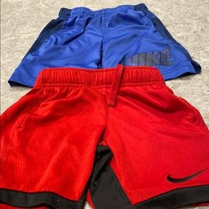 2 pair of Nike boy shorts size5 red/blue